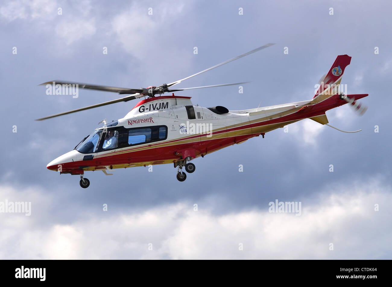 Agusta Westland AW109E Power helicopter operated by Kingfisher Airlines departing Farnborough Airport, UK. - Stock Image