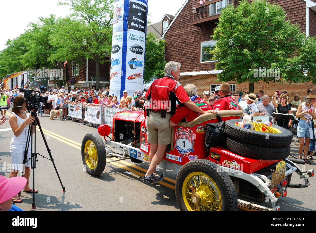Car No 1 driven by local merchant crosses Fairport leg of The Great Race around the Great Lakes - Stock Image