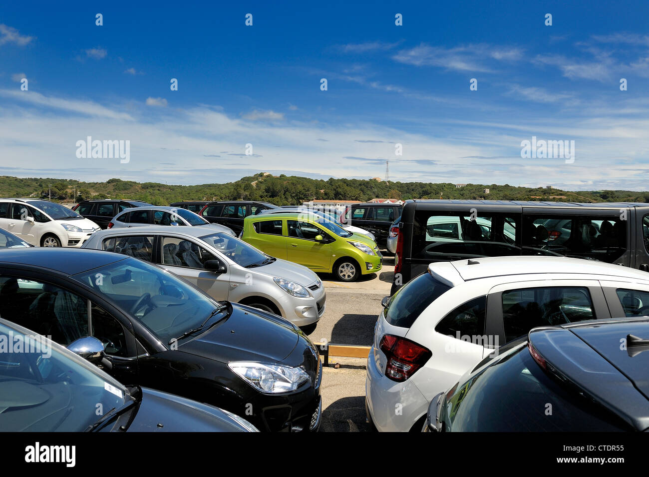 new cars in the harbour mahon menorca spain - Stock Image