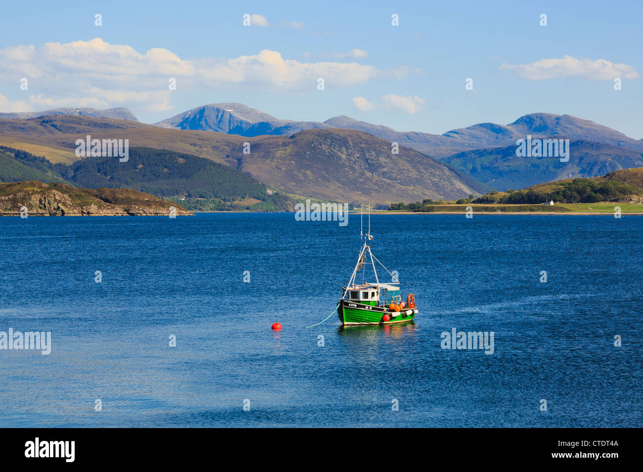 Small fishing boat moored on Loch Broom with stunning view to mountains on north west Scottish highlands coast Ullapool - Stock Image