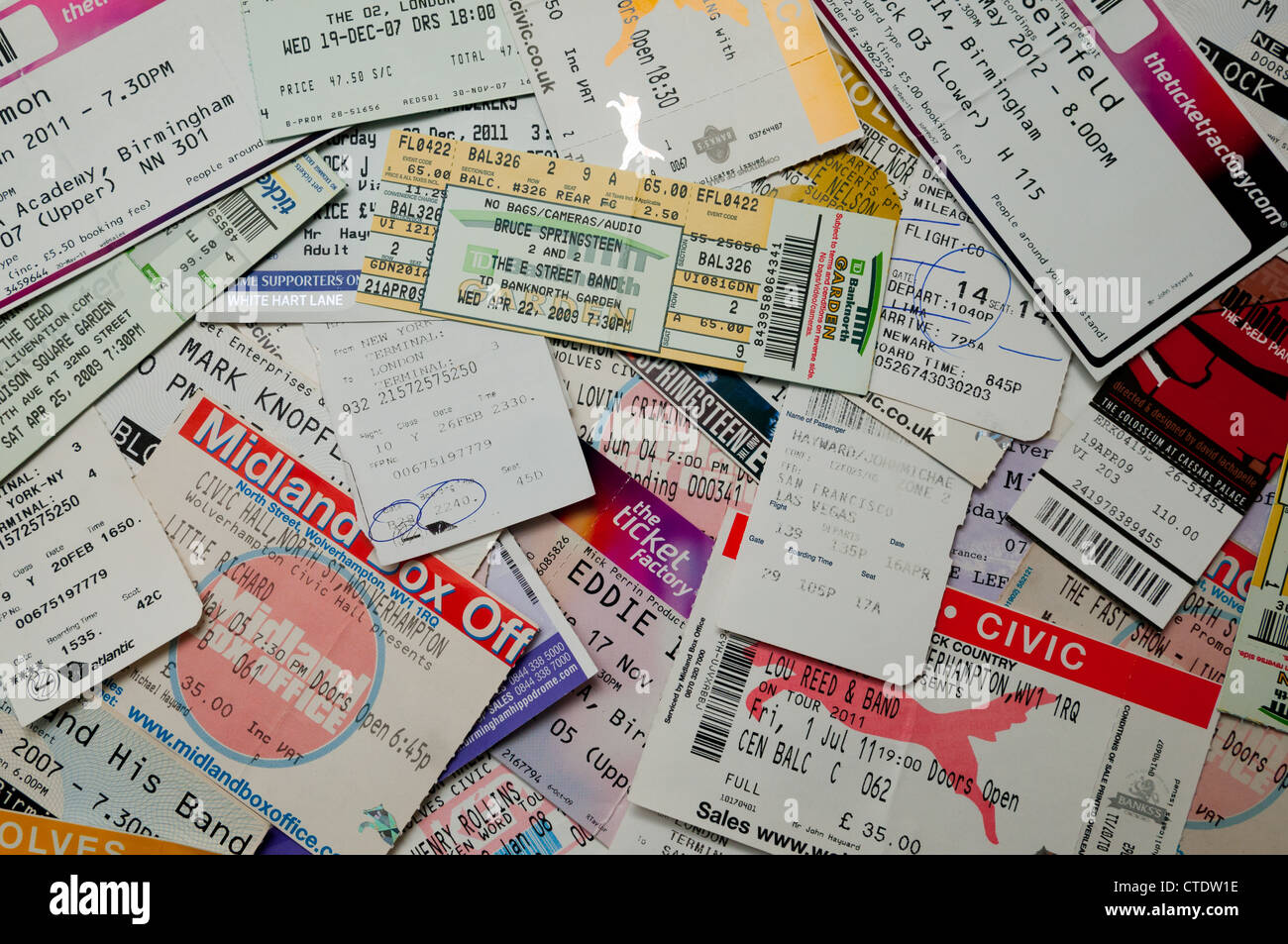 A pile of concert and airplane tickets - Stock Image