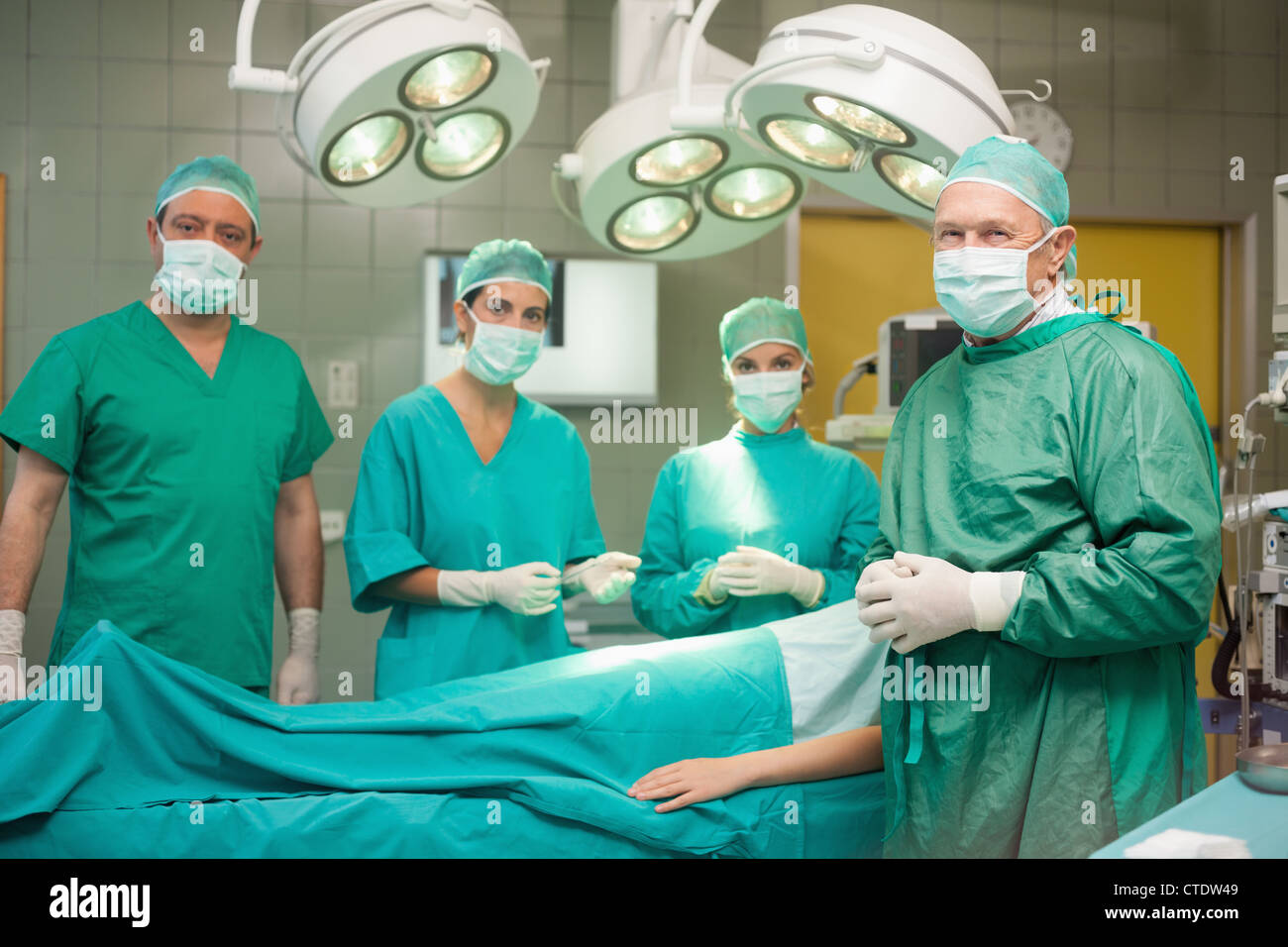Medical team surrounding a patient - Stock Image