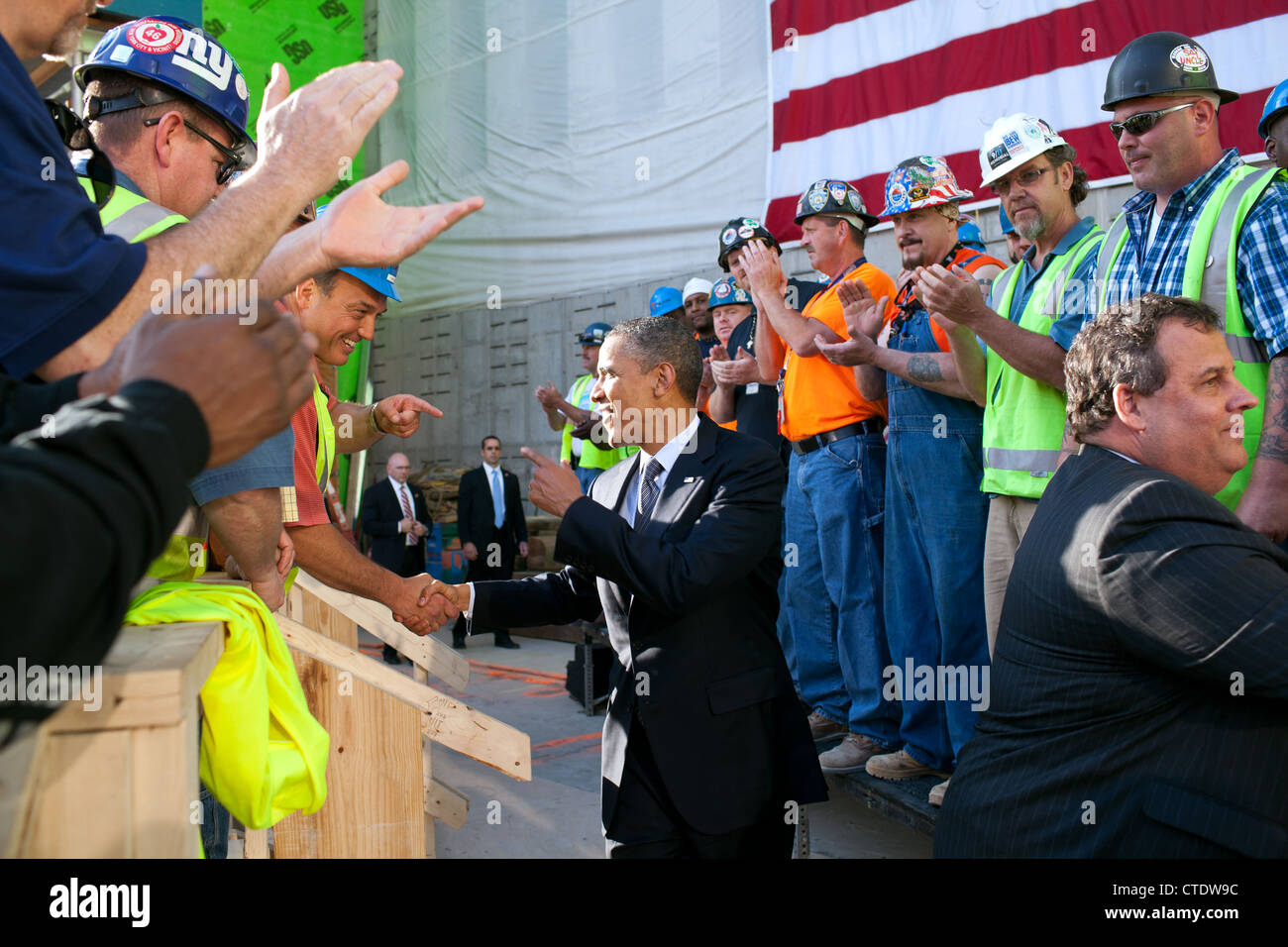 US President Barack Obama and New Jersey Governor Chis Christie, right, greet workers during a tour of the One World - Stock Image