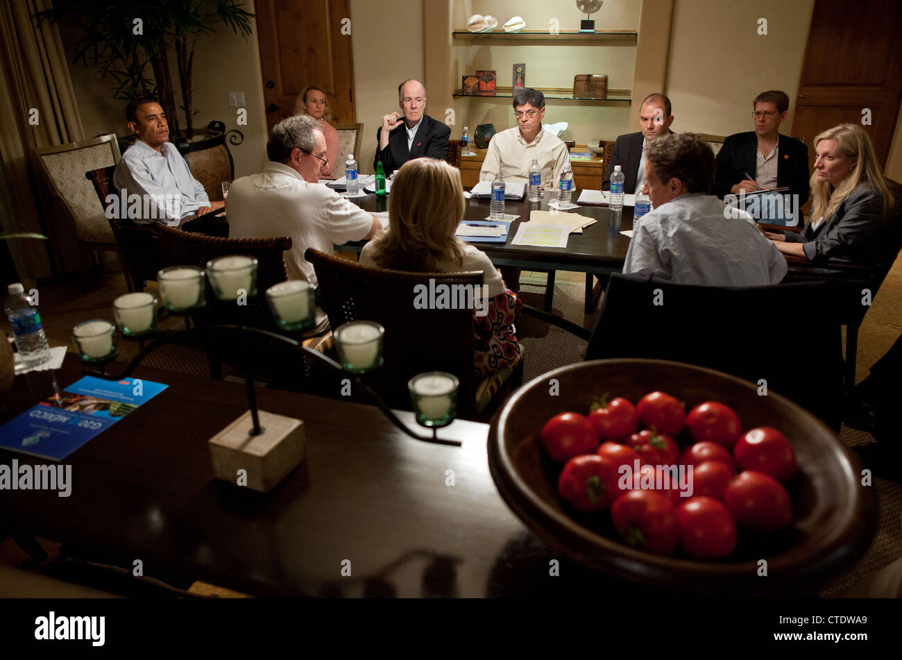 US President Barack Obama is briefed by senior advisors at the Esperanza Resort on the eve of the G20 Summit June - Stock Image