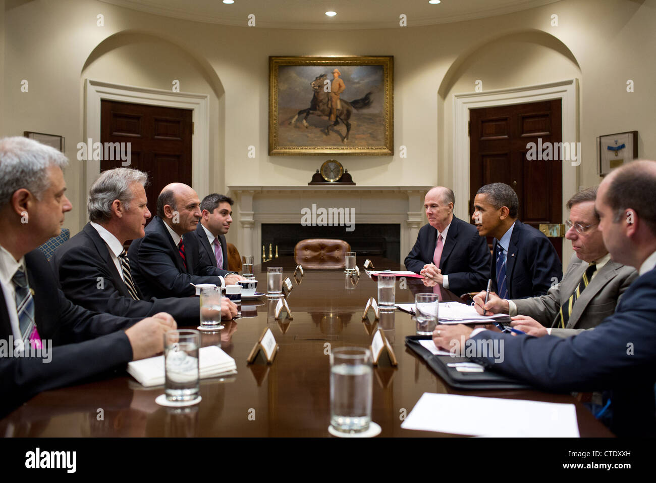 US President Barack Obama drops by a meeting between National Security Advisor Tom Donilon and Deputy Prime Minister - Stock Image