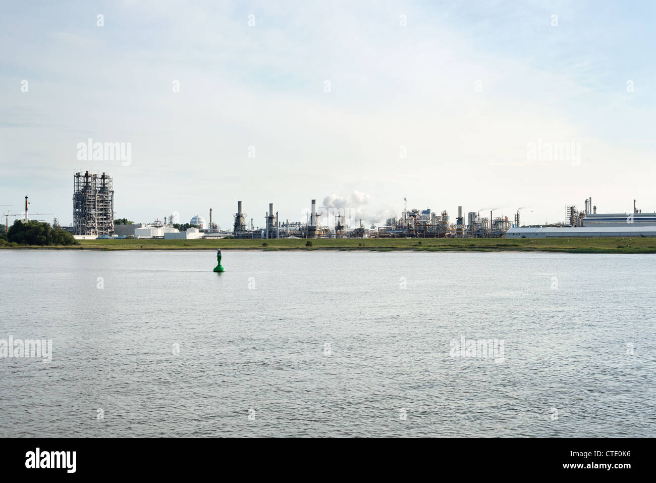 Chemical industries near river in Stade, Germany - Stock Image