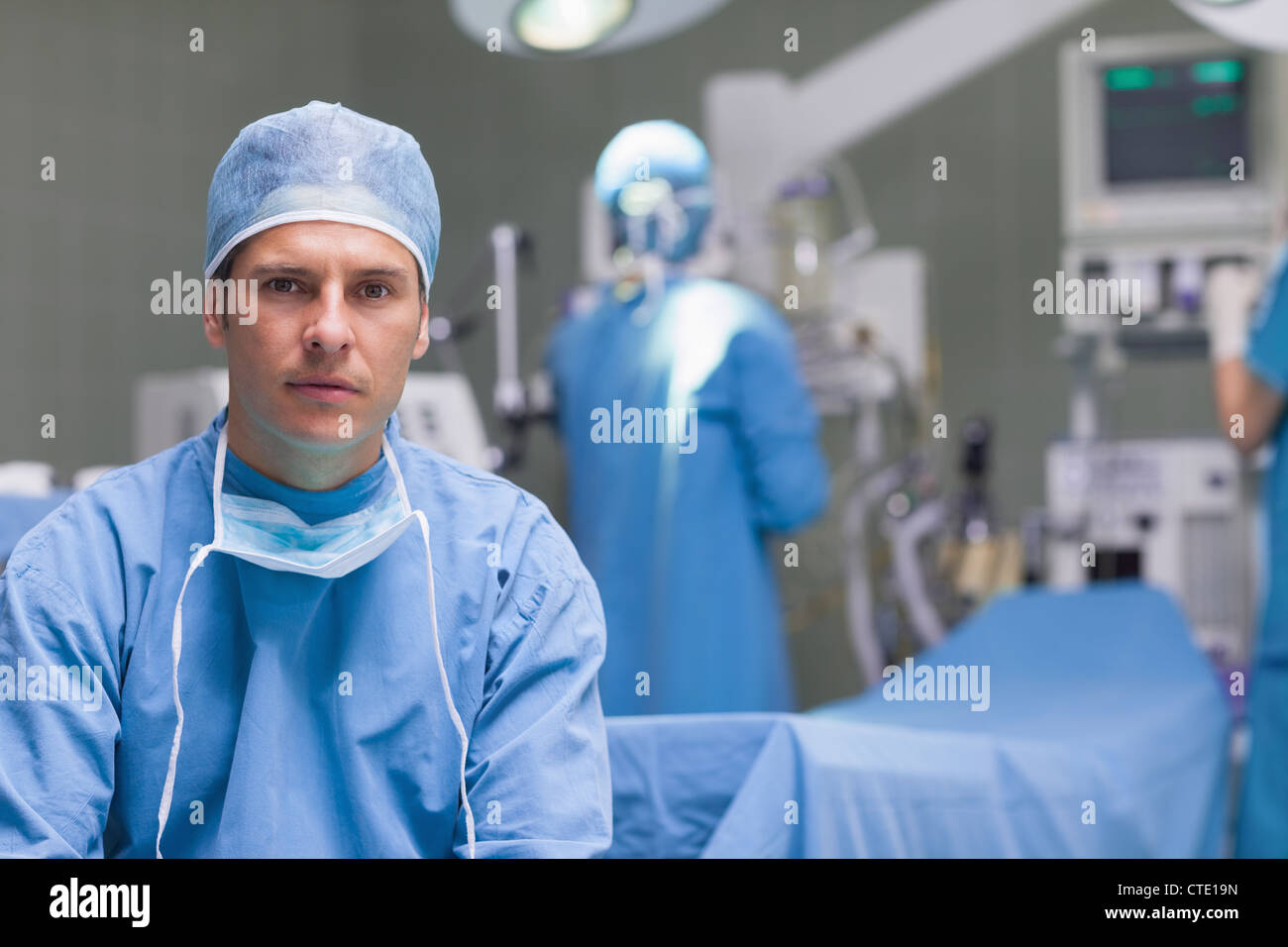Practitioner next to operating table - Stock Image