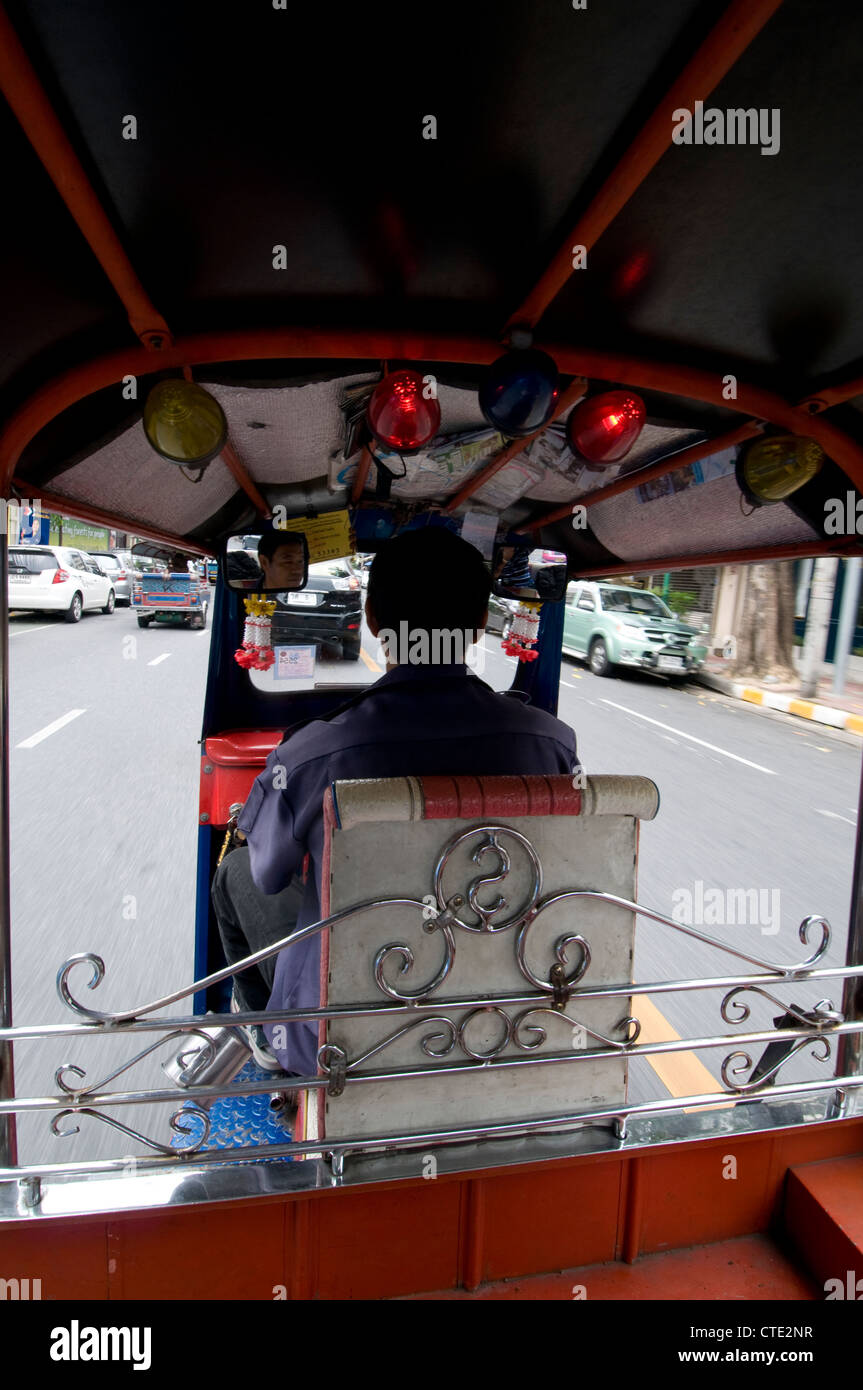 A passenger's view sitting in the back of a Tut-tut in Bangkok,Thailand - Stock Image