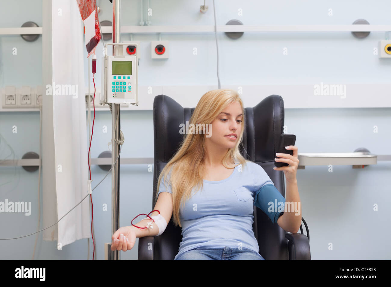 Woman receiving a blood transfusion - Stock Image