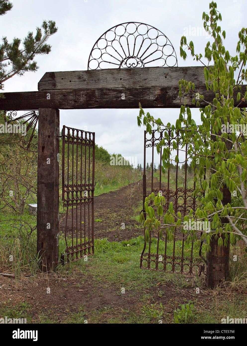 Wood and Iron Garden Gate Stock Photo