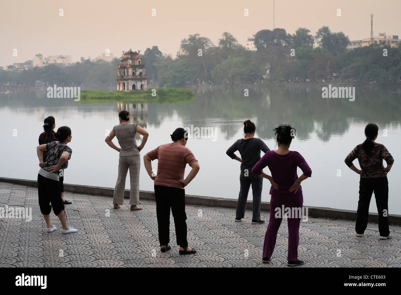 Evening Tai Chi exercises beside Hoan Kiem Lake in Hanoi Vietnam - Stock Image