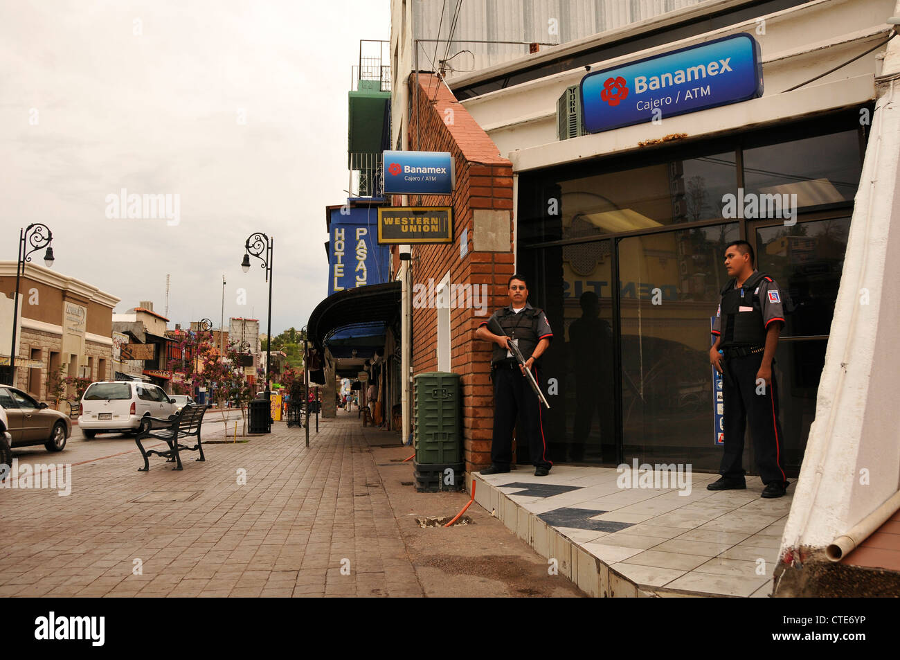 Security guards guard a bank along Calle Obregon in Nogales, Sonora, Mexico, across the border from Nogales, Arizona, - Stock Image