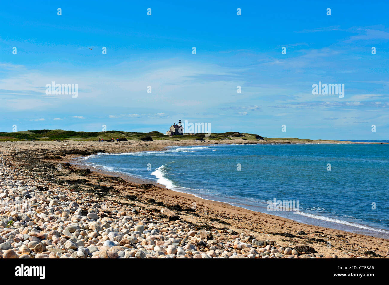 View of North Light Lighthouse and rocky beach, Sandy Point, north end of Block Island, RI - Stock Image
