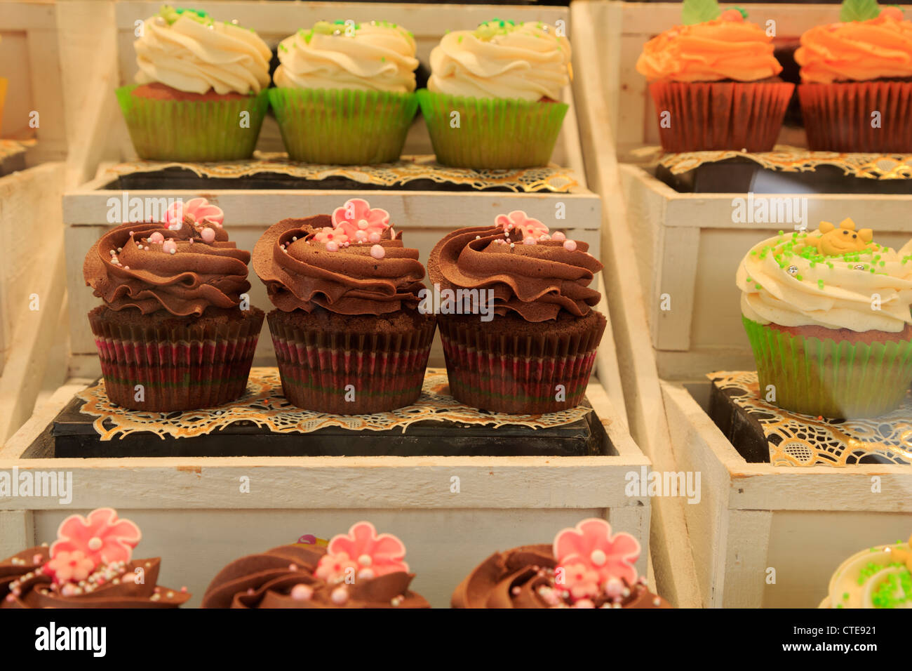 A Display Of Pretty Cupcakes In A Shop Window Stock Photo