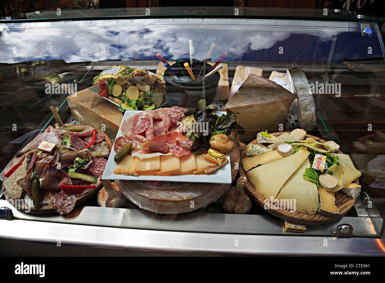 A display of meat and cheese platters in a chiller cabinet outside a Paris bistro. - Stock Image