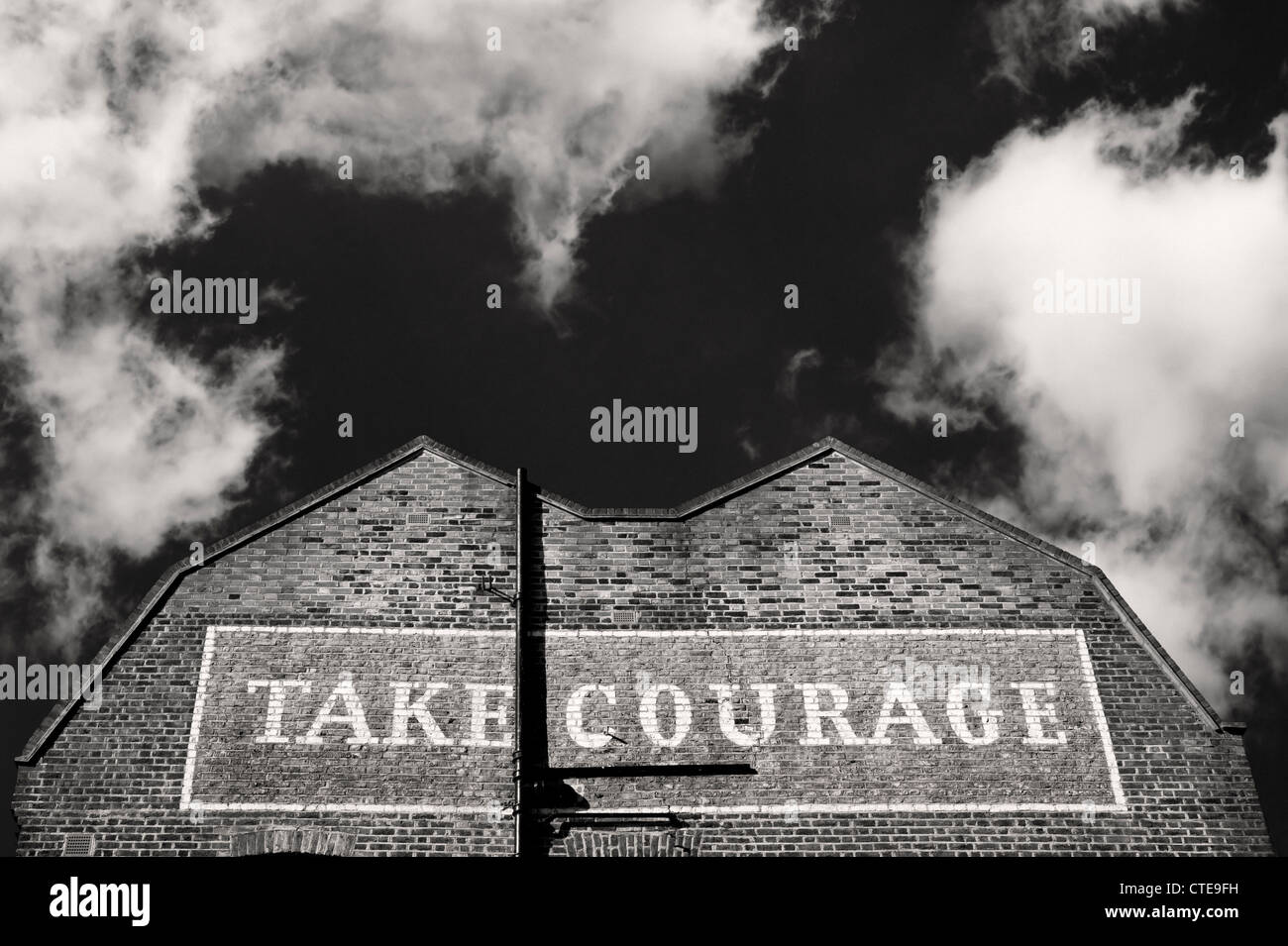 Building in Southwark London with Take Courage painted on it - Stock Image