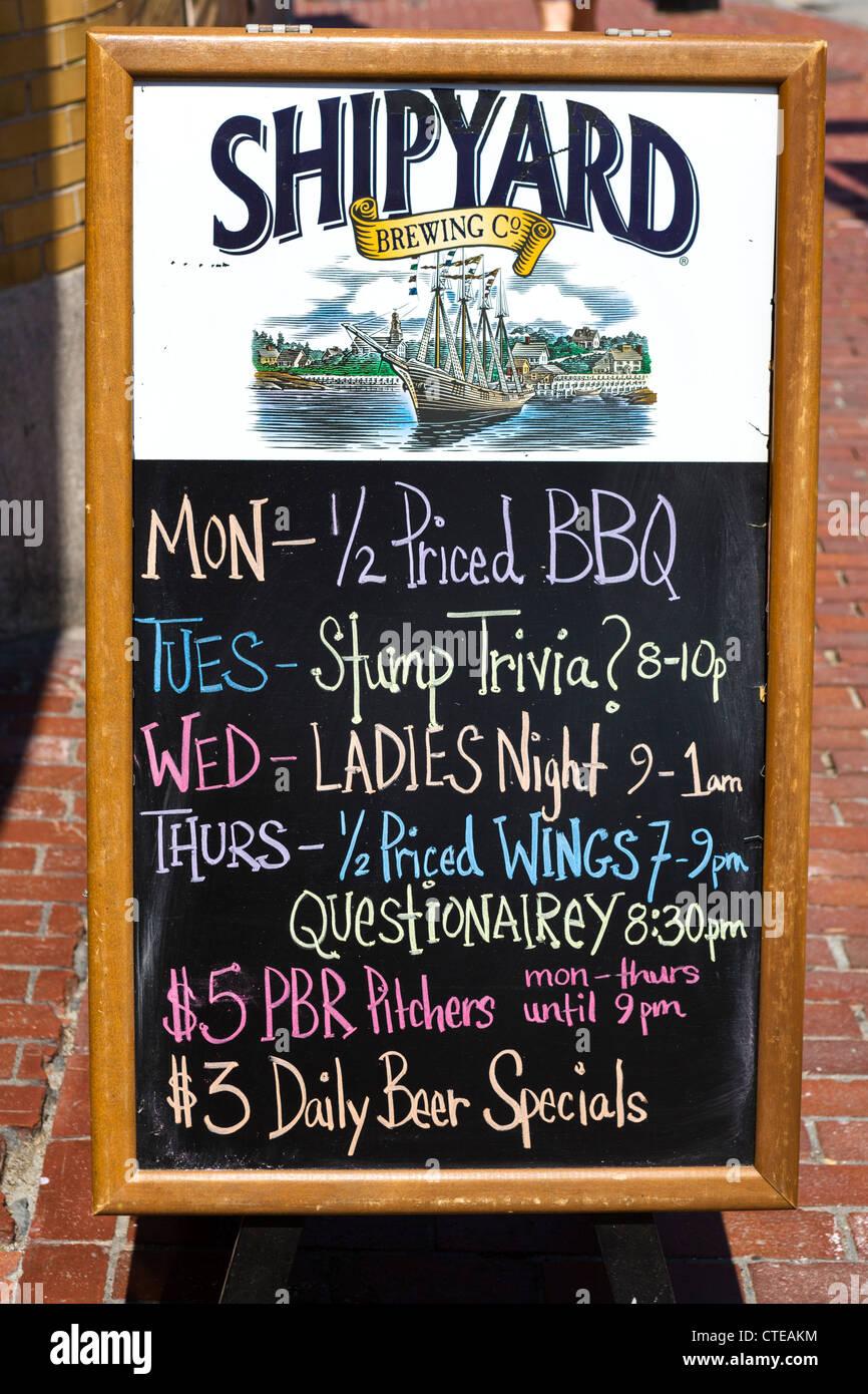 Blackboard menu outside a bar in downtown Portland, Maine, USA - Stock Image