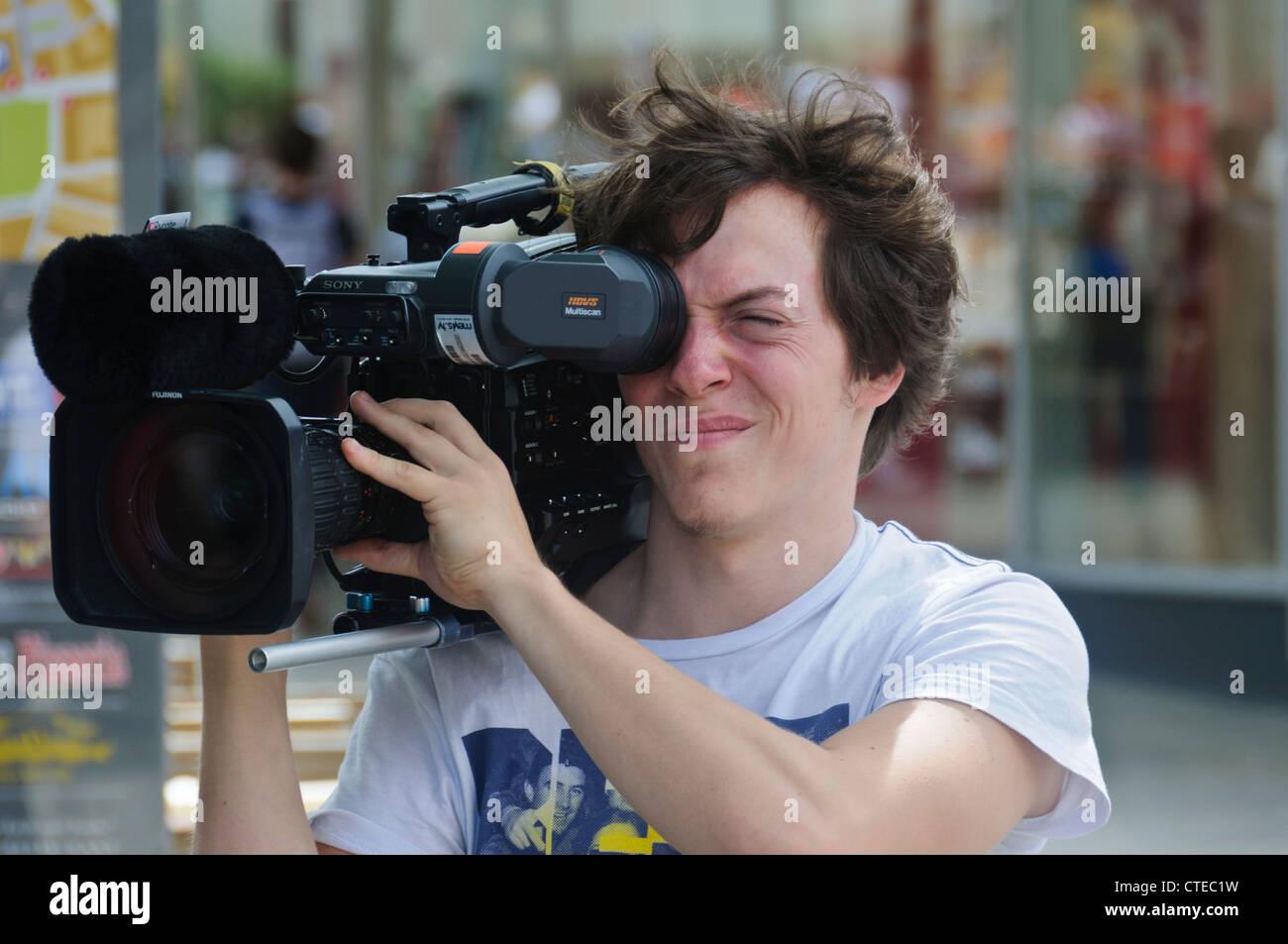 Television TV Cameraman with SONY XDCAM Power HAD FX HDVS Multiscan Digital TV Camera Fujinon Super Wide TV Zoom - Stock Image