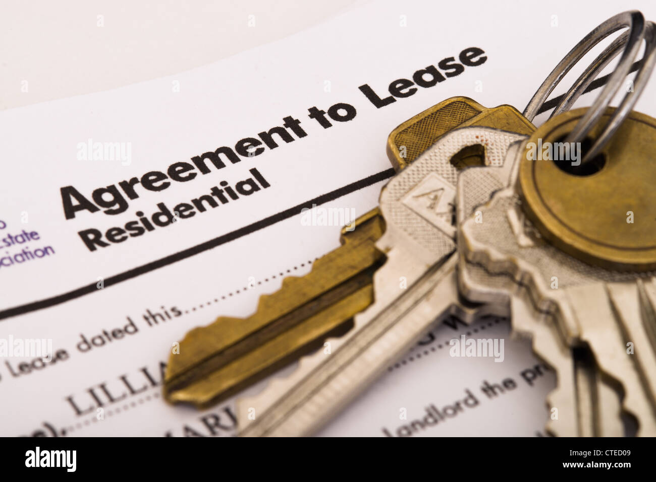 Keys and a lease agreement - Stock Image
