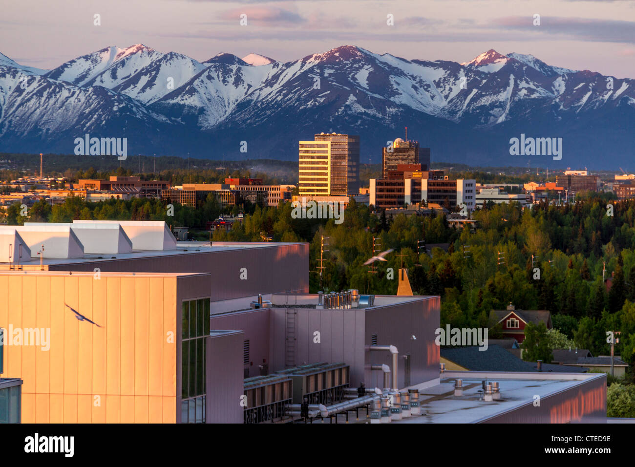 Sunrise in downtown Anchorage, Alaska, at about 4:30 am Alaska time on June 2. - Stock Image