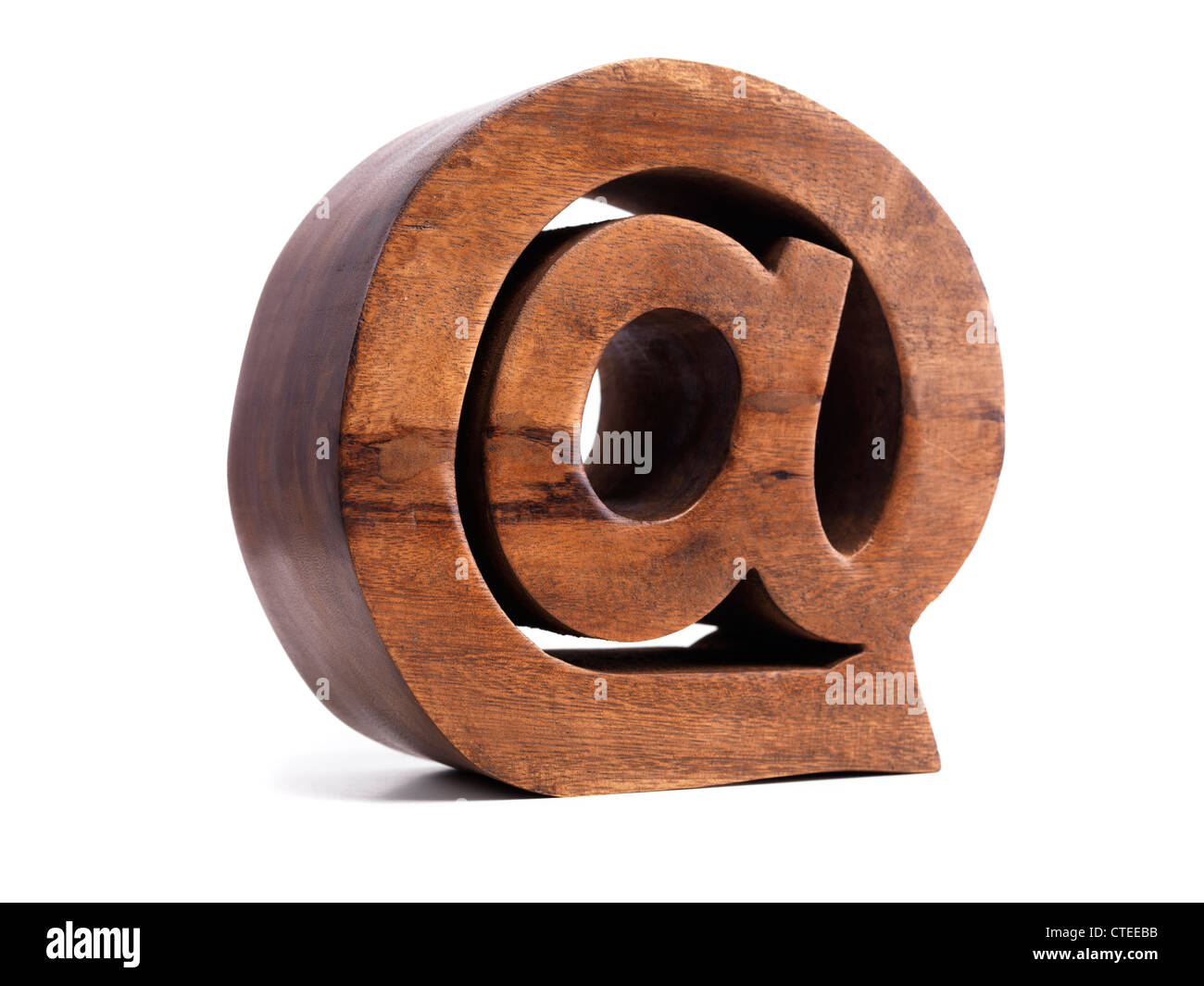 Email address symbol AT @ made of wood isolated on white background - Stock Image