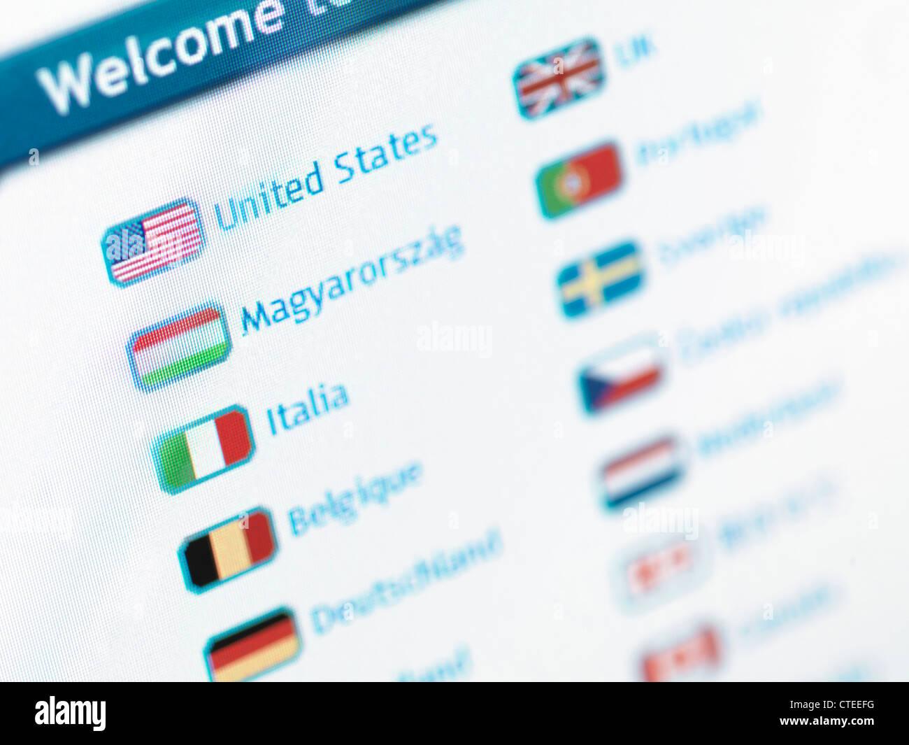 E-commerce web site language selection menu on a display - Stock Image