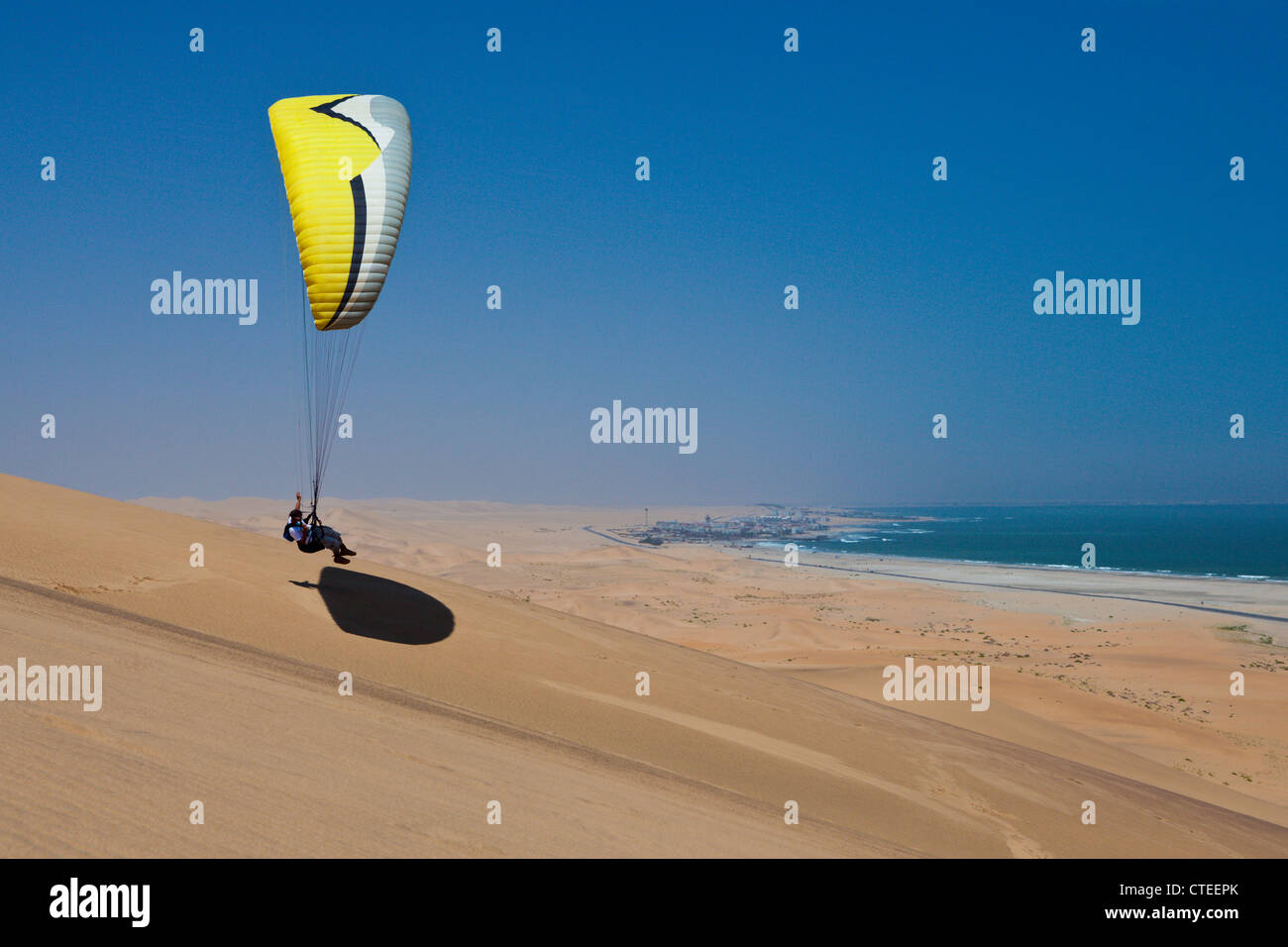 Paragliding over Dunes of Namib Desert, Long Beach, Swakopmund, Namibia - Stock Image