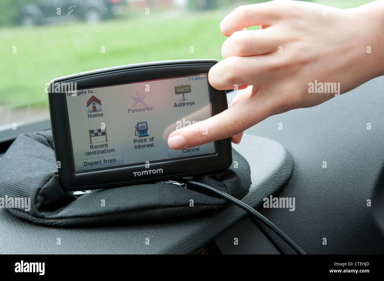 Setting up a Sat Nav device in a car - Stock Image