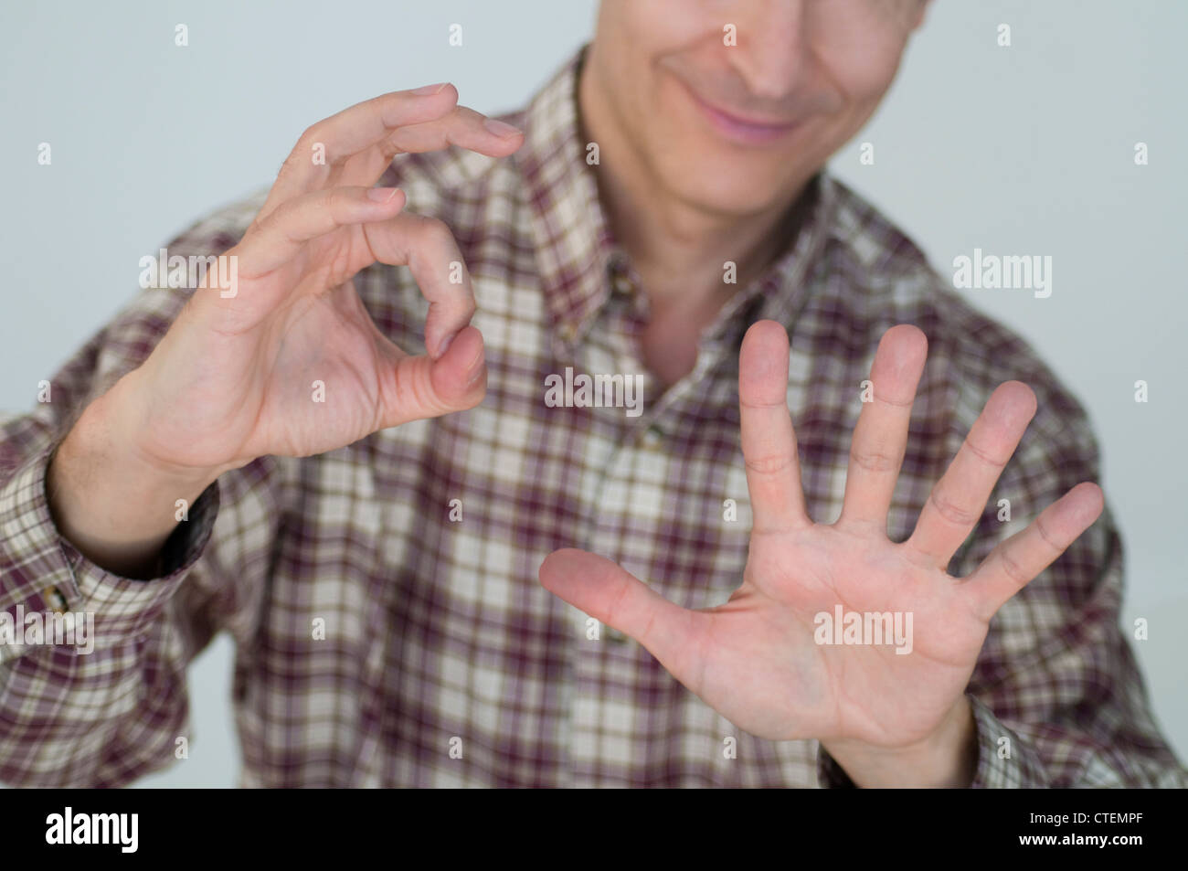 Man expressing five to zero result. - Stock Image
