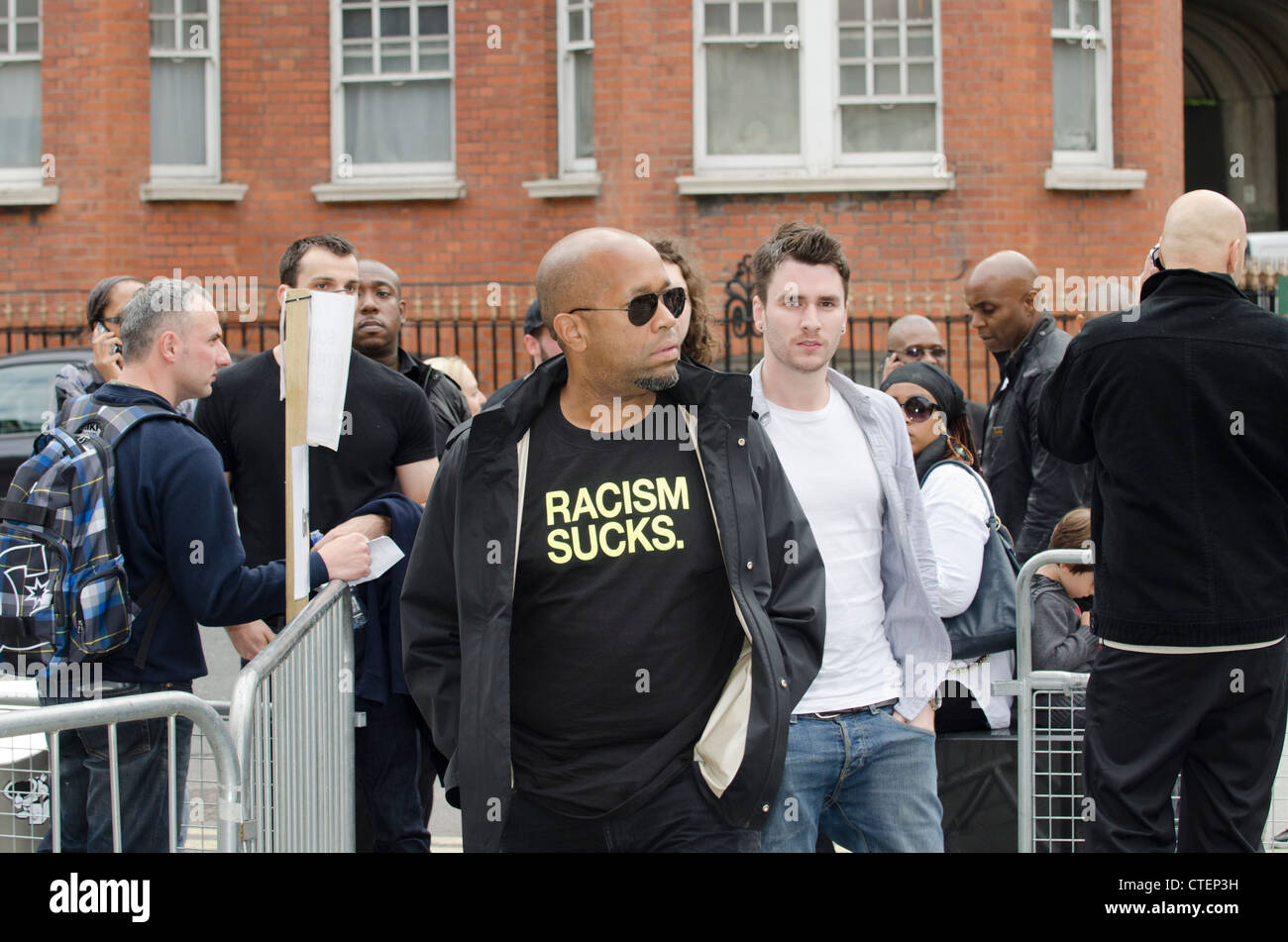 Racism Suck T shirt on guest at The Art of Rap film premiere Hammersmith Apollo, London  Uk - Stock Image