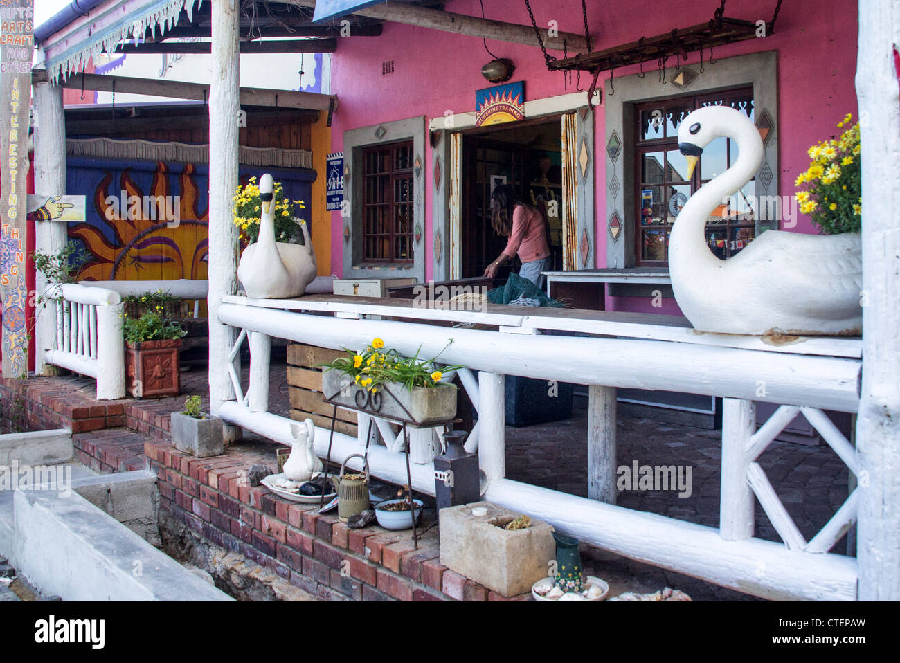Swans guard the front of trendy shop - Sunshine Trading, Kleinmond, Western Cape, South Africa - Stock Image
