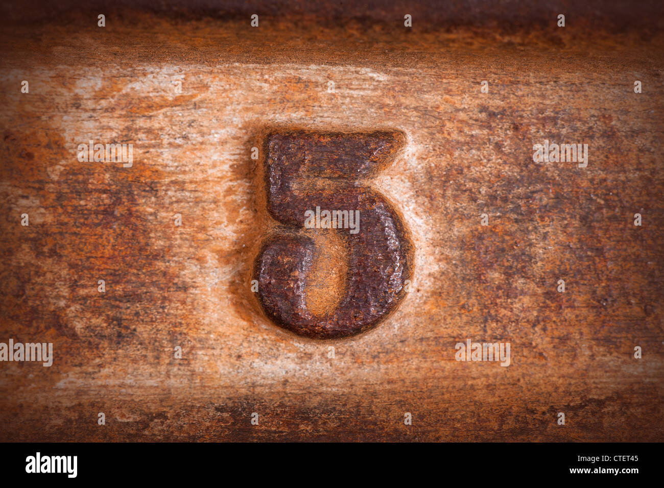 number five background on old rust plate background - Stock Image