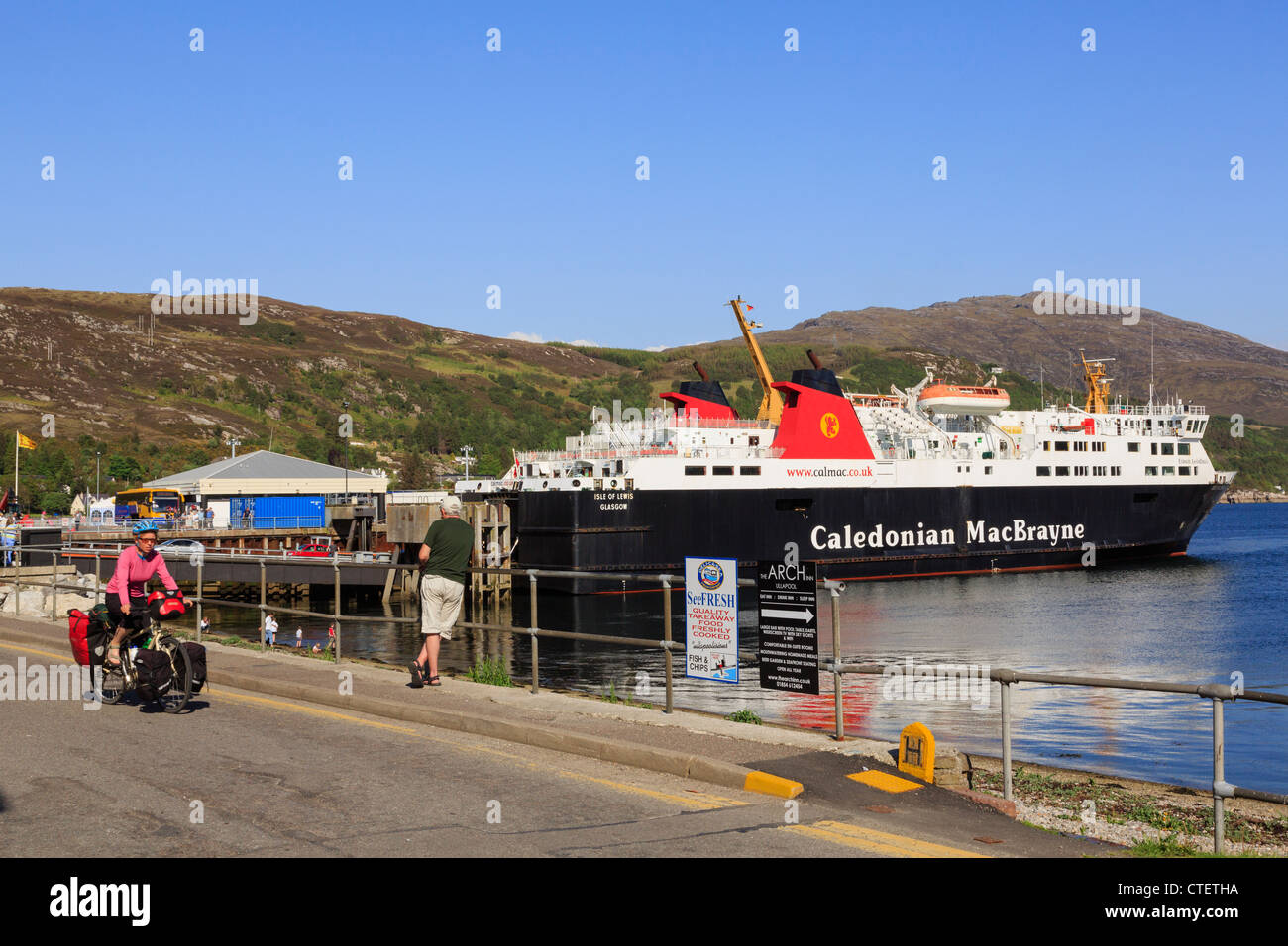 Passengers disembarking from Caledonian MacBrayne ferry from Isle of Lewis in port on Loch Broom Ullapool Highland - Stock Image