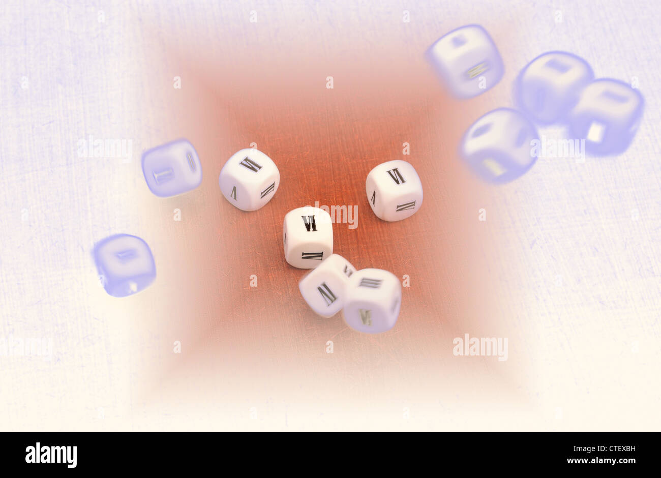Dice with Roman numerals on all six sides, bouncing around; shown on a graduated background - Stock Image