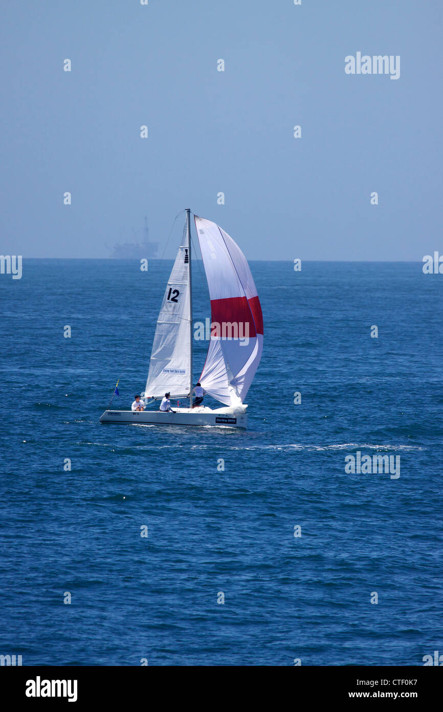 Teams compete during the Balboa Yacht Club's 46th annual Governor's Cup Regatta off Newport Beach California - Stock Image