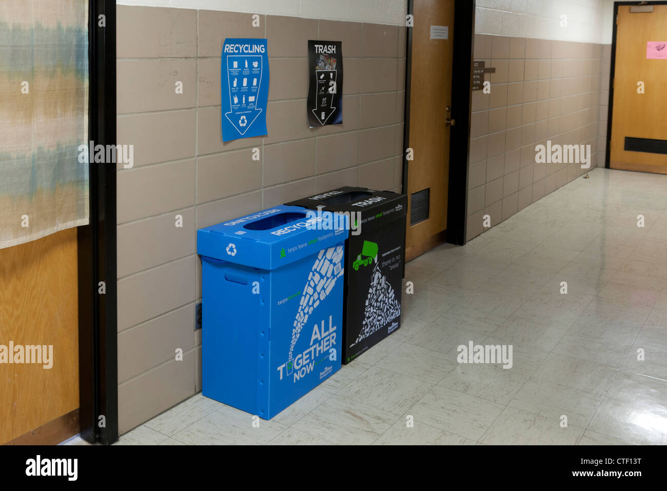 Recycle bins placed in the hallway - Stock Image