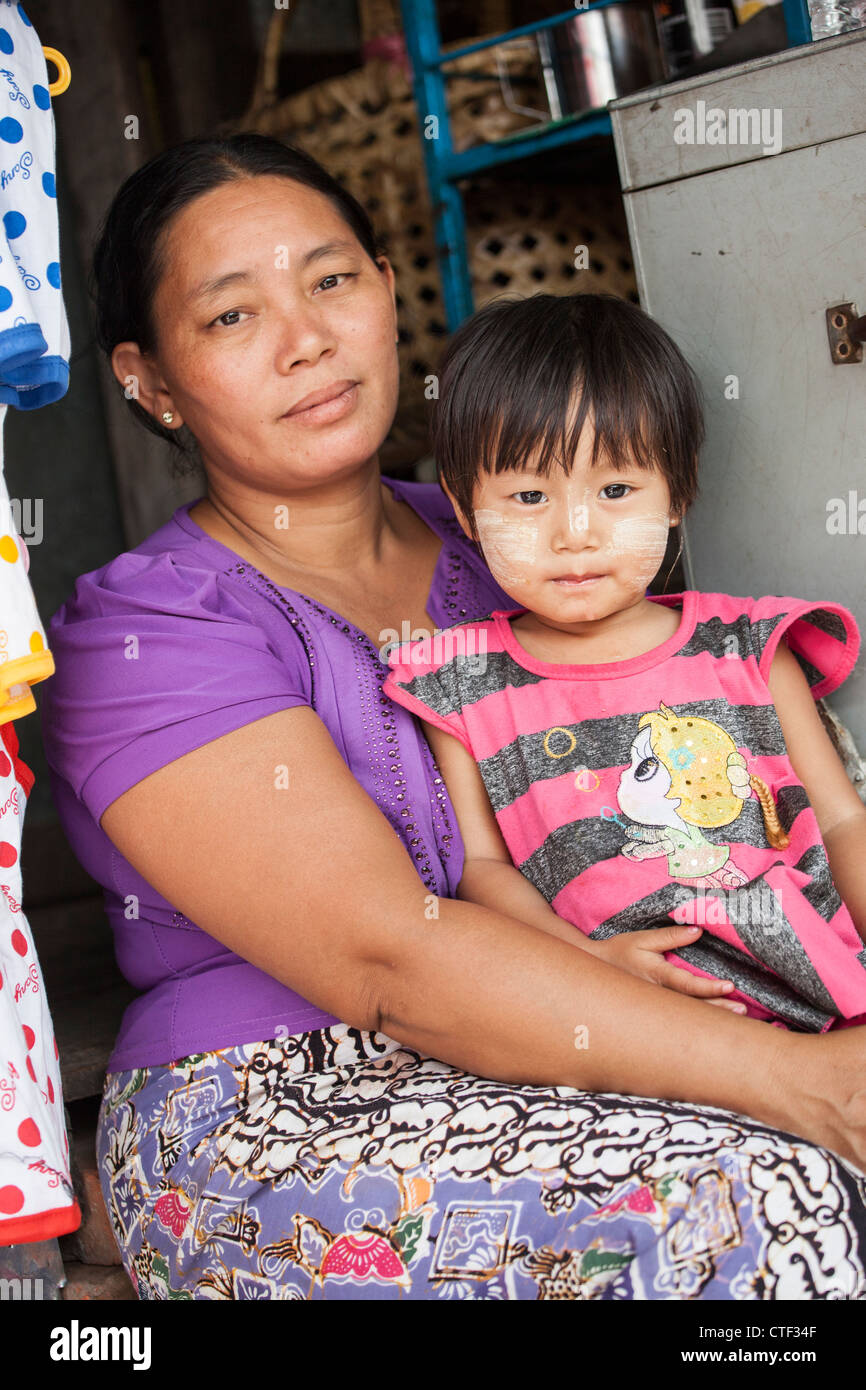 Mother and young daughter in Mandalay, Myanmar - Stock Image