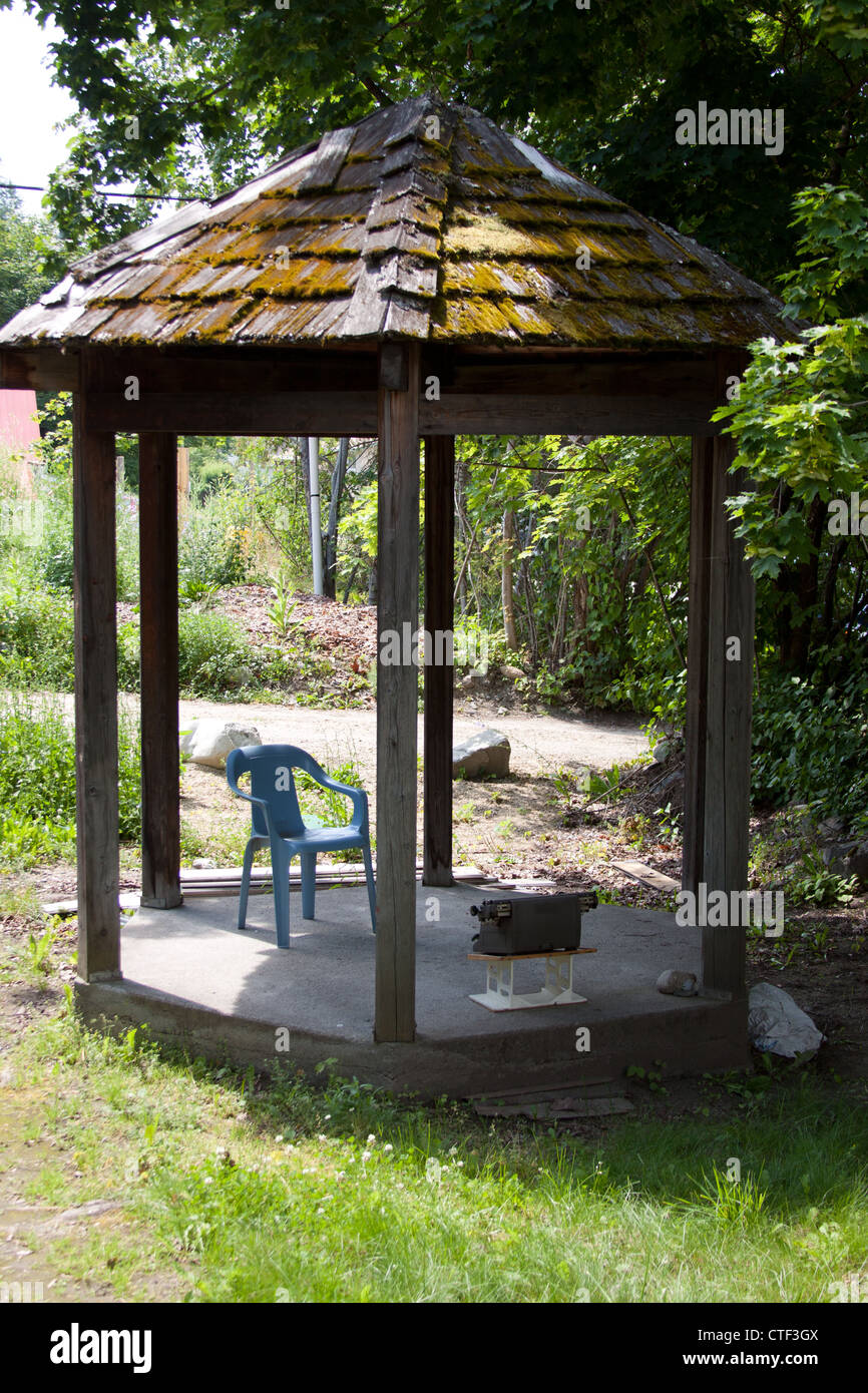 A funny little image of an outdated office, or an outside retreat. - Stock Image
