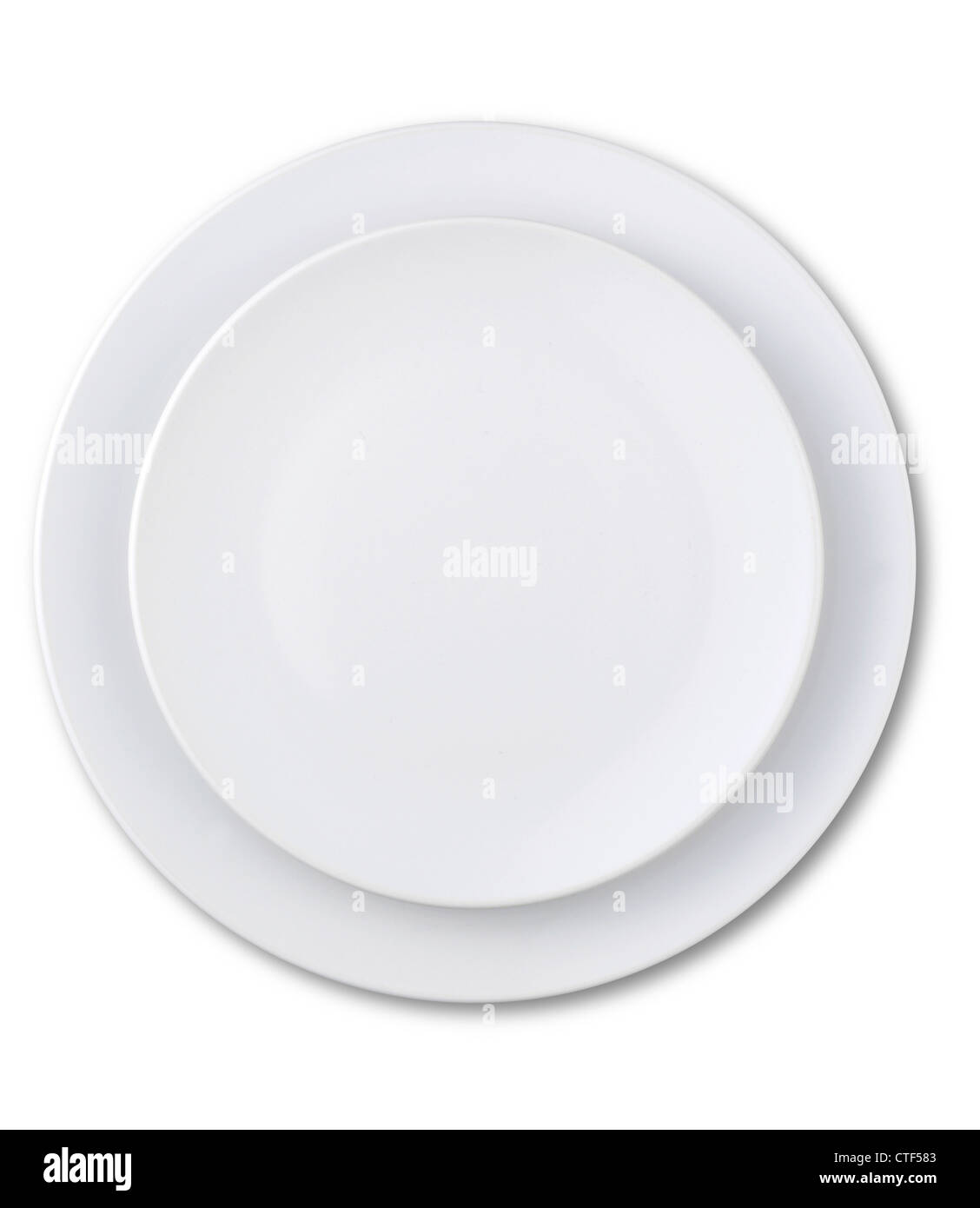 an overhead view of an empty plate isolated on white with a clipping path - Stock Image