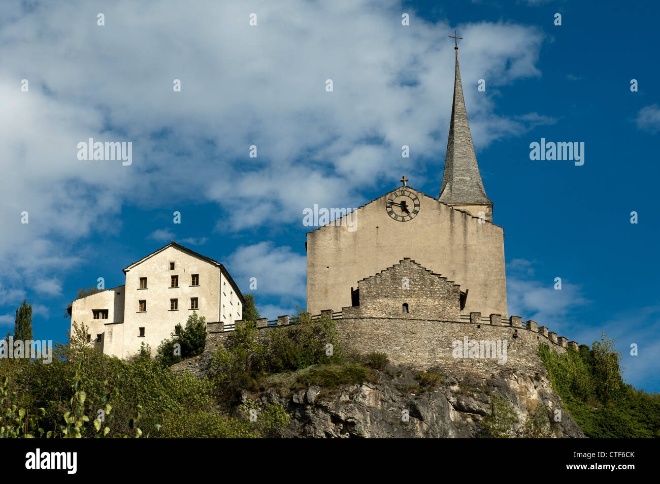 Church St. Romanus and the old rectory building, today used as mueseum, Raron, Valais, Switzerland - Stock Image