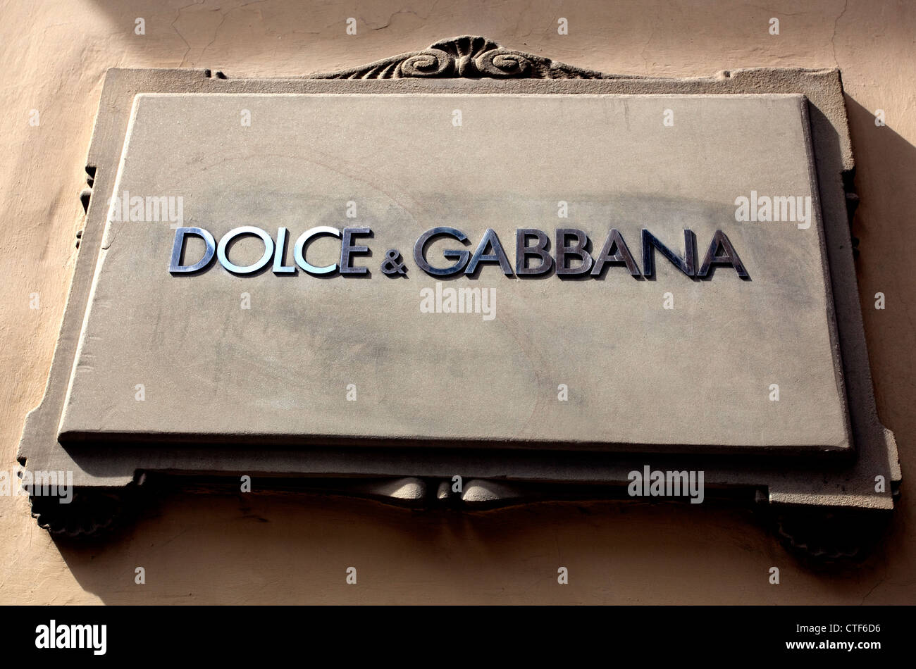 Sign on Dolce & Gabbana fashion store in Central Florence, Italy - Stock Image