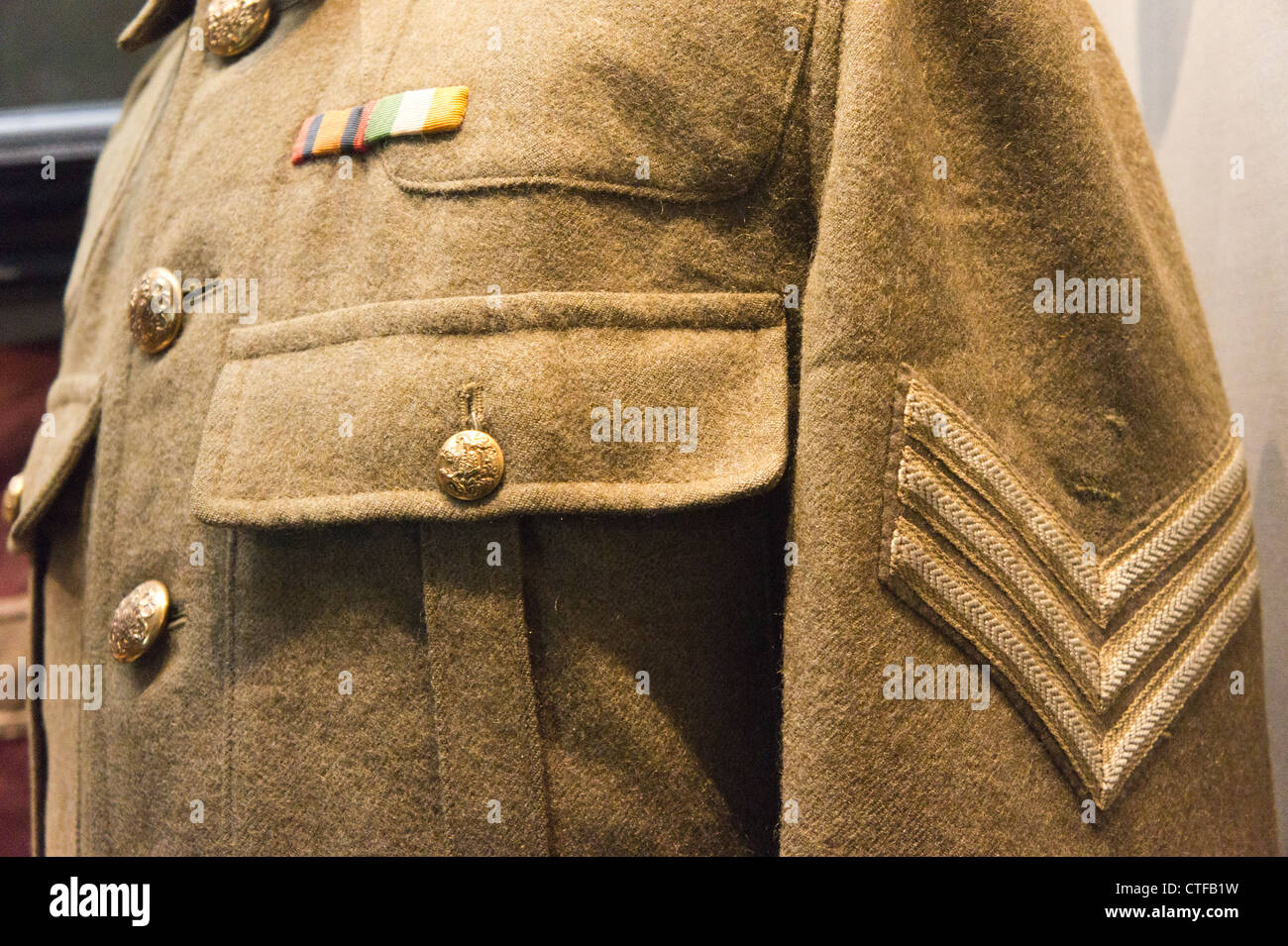 British army uniform showing medal ribbons and sergeant's stripes. - Stock Image