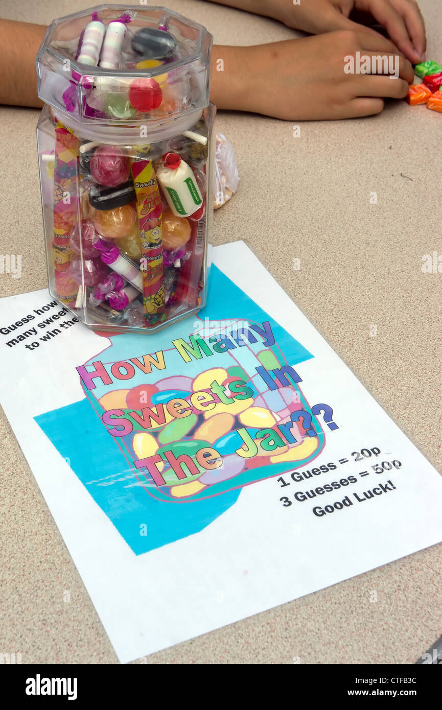 Guess how many sweets in the jar, school fete game. - Stock Image