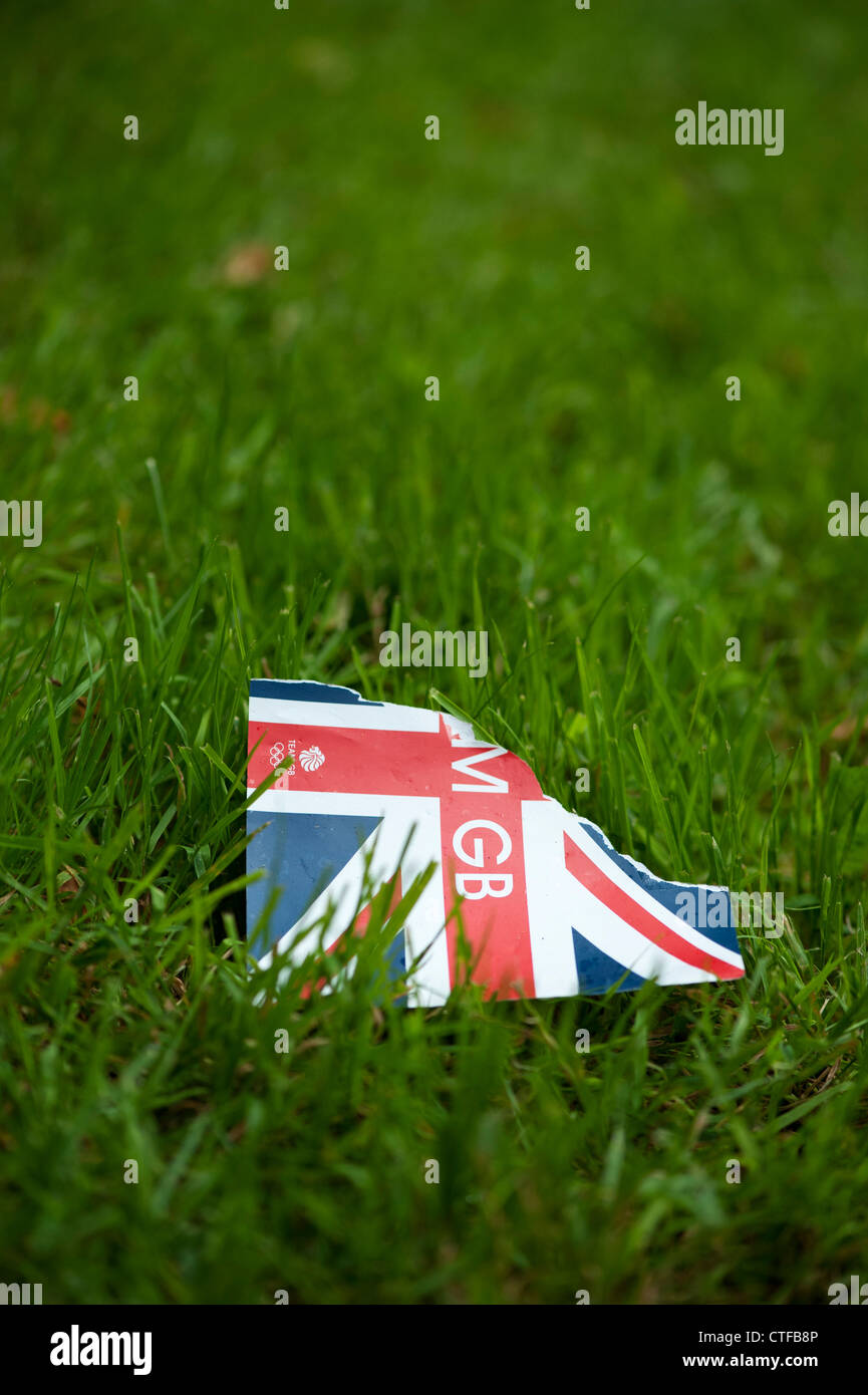 Torn Team GB leaflet littered on grass - Stock Image