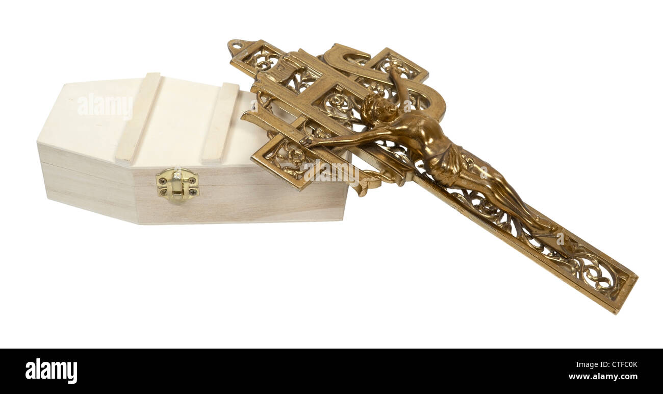 A brass cross crucifix on a wooden coffin - path included - Stock Image