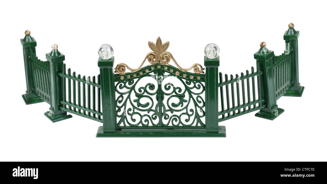 Metal curved fence with scrollwork painted green - path included - Stock Image