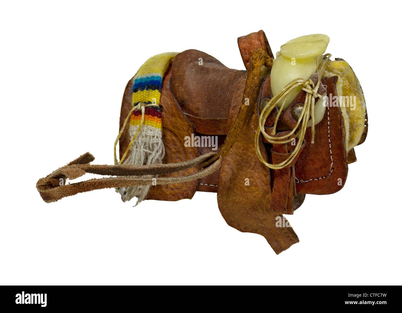 Old western saddle made of heavy leather for riding domestic horses - path included Stock Photo
