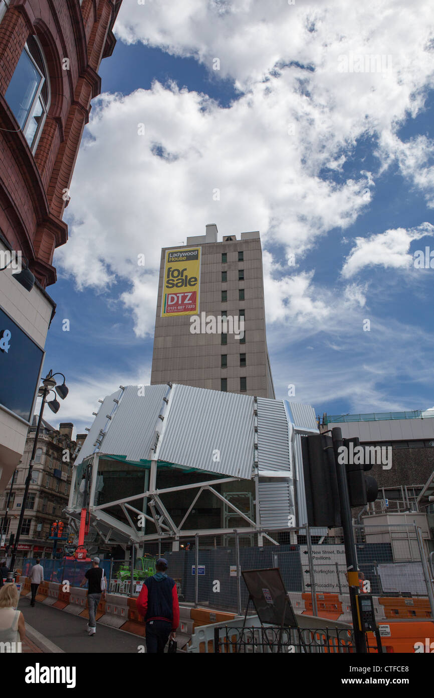 Large Office Block for sale in Birmingham and construction work on the new New Street railway station in foreground. - Stock Image