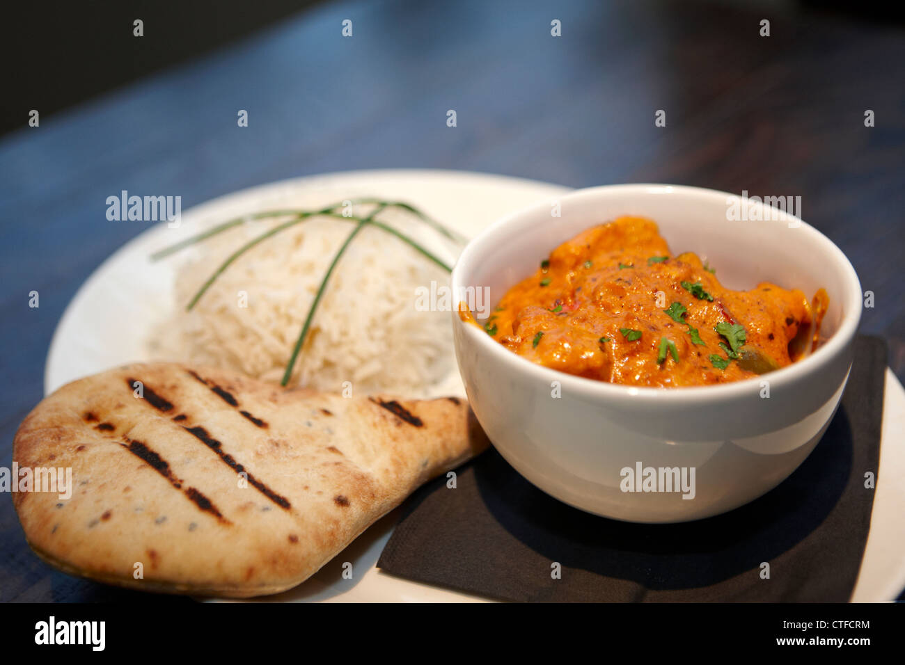 Chicken curry and naan bread with rice - Stock Image