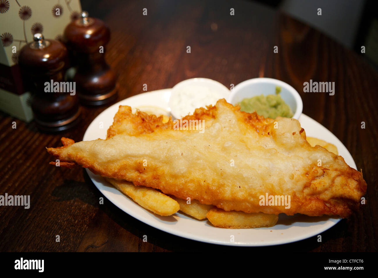 Fish and chips with mushy peas - Stock Image